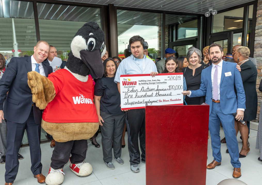 (From left) Wawa Director of Operations Jason Read, Tara Murphy, Patrick Murphy, Aleta Murphy, Eden Chief Development Officer Melinda Gorny McAleer, and Wawa Area Manager Daniel Holland present Wawa's $100,000 donation to Eden Autism on May 9.